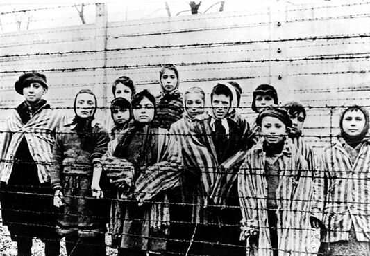 A photo taken just after the liberation by the Soviet army shows a group of children wearing concentration camp uniforms at the Auschwitz Nazi concentration camp on January 27, 1945. Miriam Friedman Ziegler, nine-years-old at the time, is second from left. Friedman Ziegler, who lives in Thornhill, Ont., is among about 100 survivors who are returning to Poland this week to commemorate the 70th anniversary of the liberation of Auschwitz. THE CANADIAN PRESS/AP
