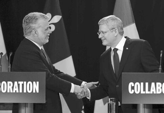 All smiles from Prime Minister Stephen Harper and Quebec Premier Philippe Couillard at an announcement in Quebec in June.
