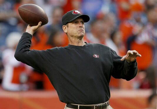 San Francisco 49ers head coach Jim Harbaugh warms up with his team prior to an NFL football game against the Denver Broncos, Sunday, Oct. 19, 2014, in Denver. (AP Photo/Joe Mahoney)