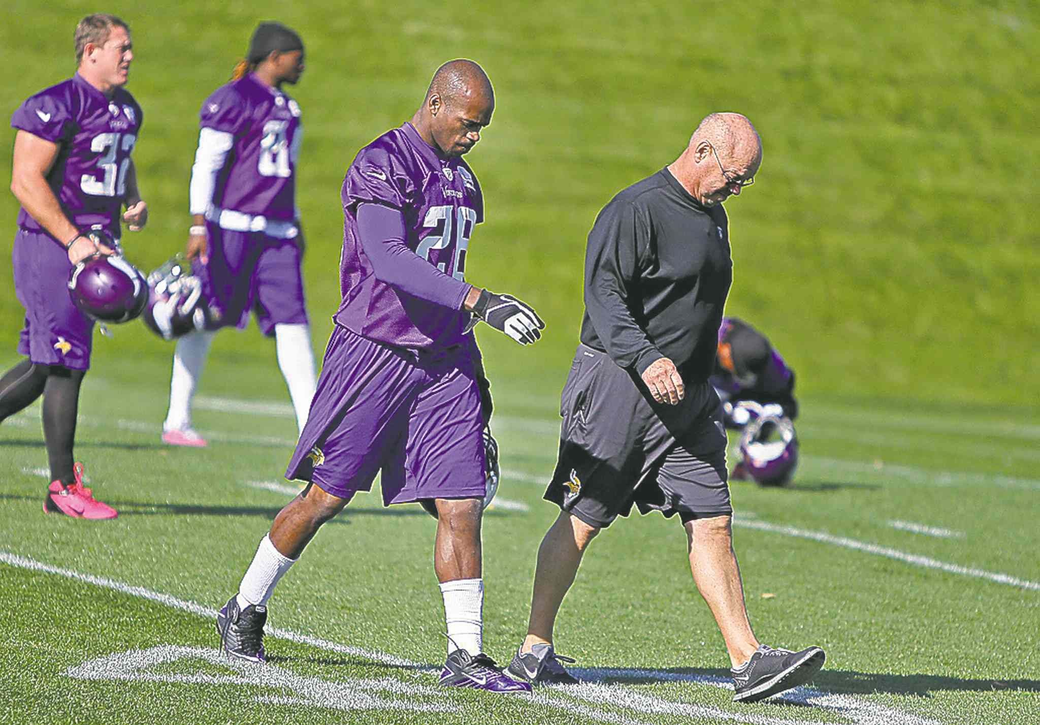 Elizabeth Flores / the associated pressAdrian Peterson, second from right, starts practice Friday.