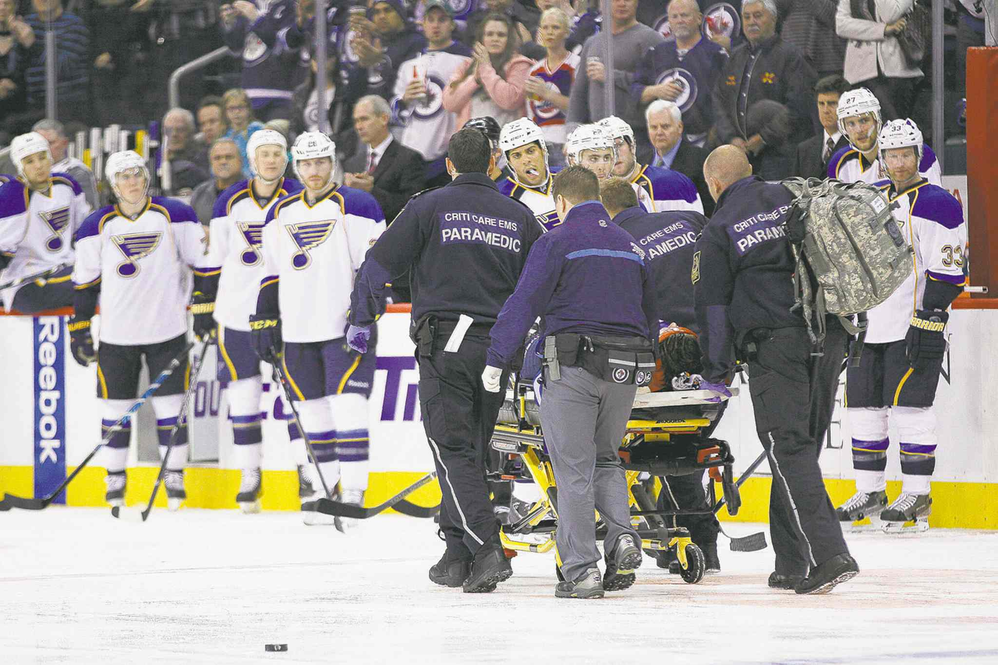 John Woods / the canadian pressWinnipeg Jets D-man Jacob Trouba is taken off the ice by paramedics after crashing headfirst into the boards during the second period Friday night.