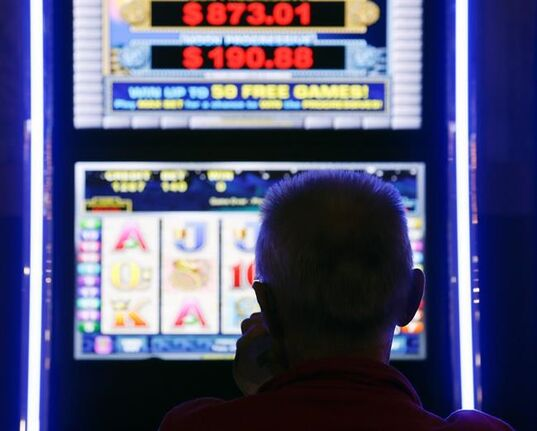 A man plays at a video lottery terminal at Tioga Downs, in Nichols, N.Y., in a Thursday, Oct. 16, 2014 file photo. The Supreme Court of Newfoundland and Labrador has certified a class action lawsuit against the Atlantic Lottery Corporation that alleges VLT line games are designed to deceive players.THE CANADIAN PRESS/AP/Mike Groll