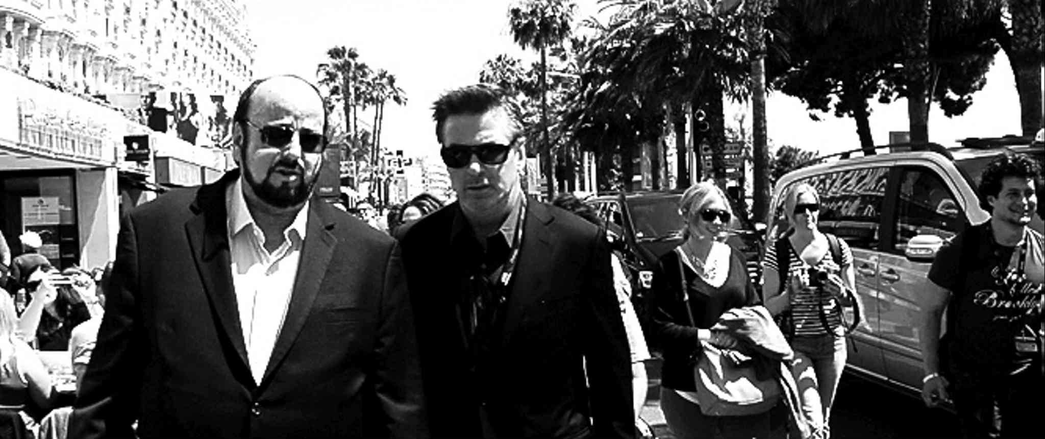 Toback (left)  and Baldwin search  for money  on the streets  of Cannes.