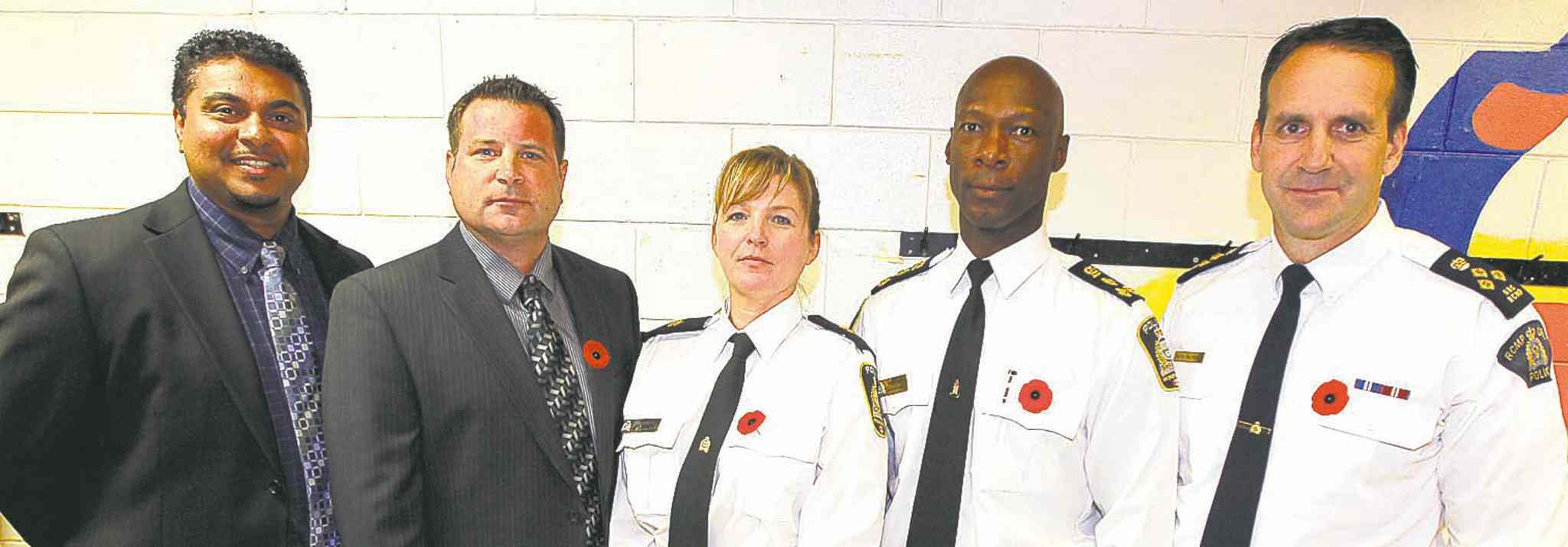 From left, Winnipeg Police Service Det.-Sgt. Darryl Ramkissoon, Sgt. Gene Bowers, Insp. Liz Pilcher, Chief Devon Clunis and RCMP D Division Assistant Commissioner Kevin Brosseau announce the new anti-prostitution approach Friday at the William Whyte Residents' Association office at 295 Pritchard Ave.