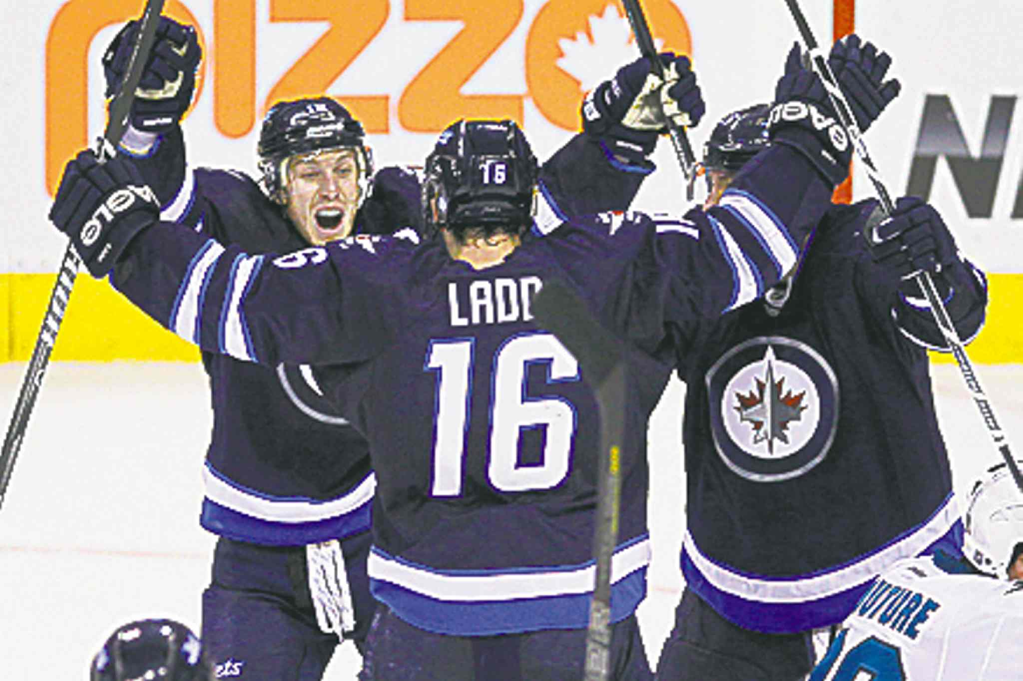 Winnipeg Jets' Bryan Little (18), Blake Wheeler (26) celebrates Andrew Ladd's (16) late game tying goal against San Jose Sharks in third period NHL action in Winnipeg on Sunday, November 10, 2013. (John Woods / WINNIPEG FREE PRESS)