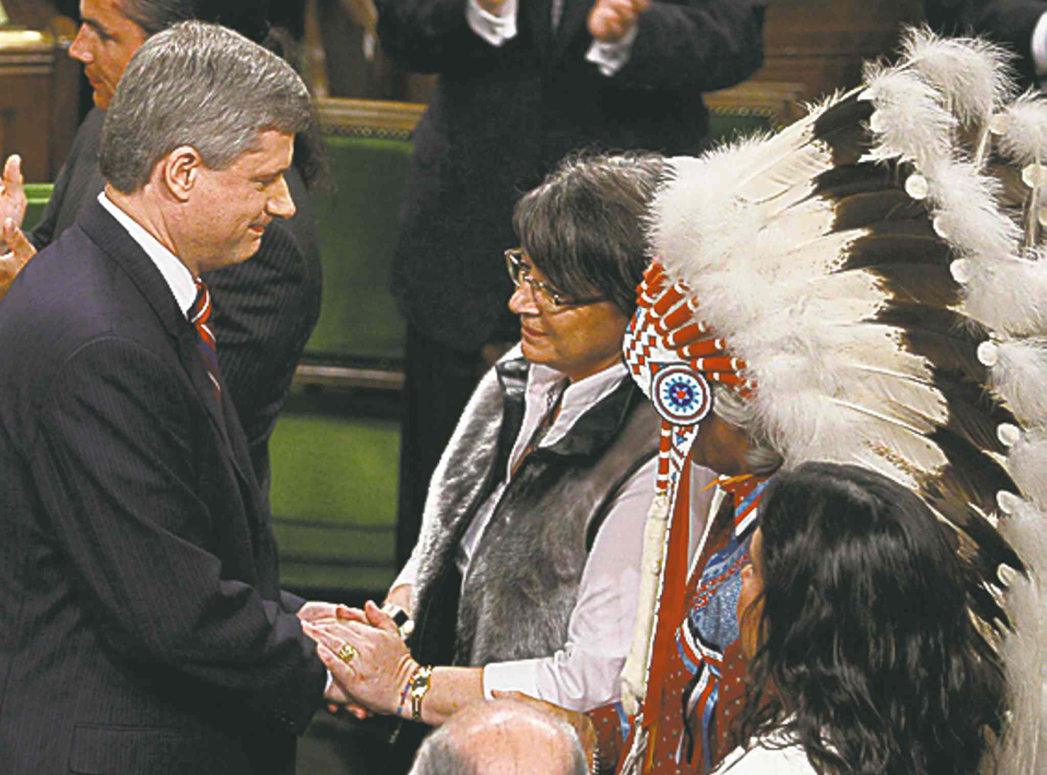 FRED CHARTRAND / THE ASSOCIATED PRESS ARCHIVESInuit Tapiriit Kanatami President Mary Simon shakes hands with Prime Minister Stephen Harper, as Assembly of First Nations Chief Phil Fontaine (headdress) watches, after the government�s official apology for more than a century of abuse and cultural loss involving Indian residential schools.