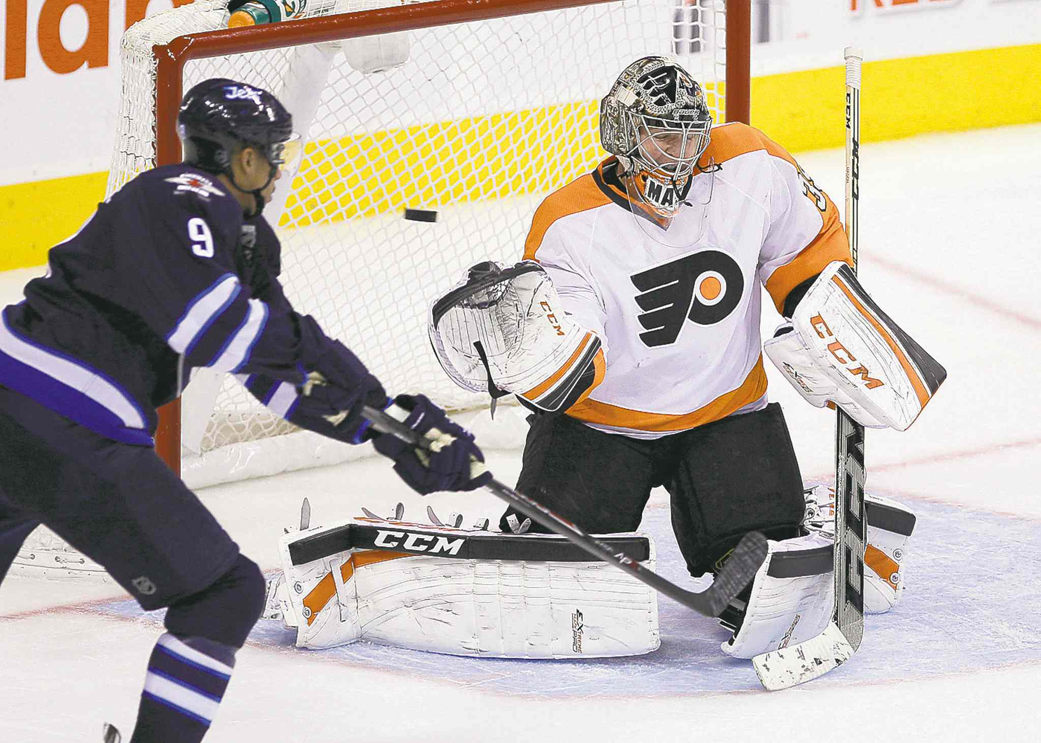 The Jets put two power-play goals past Flyers netminder Steve Mason on Friday night.