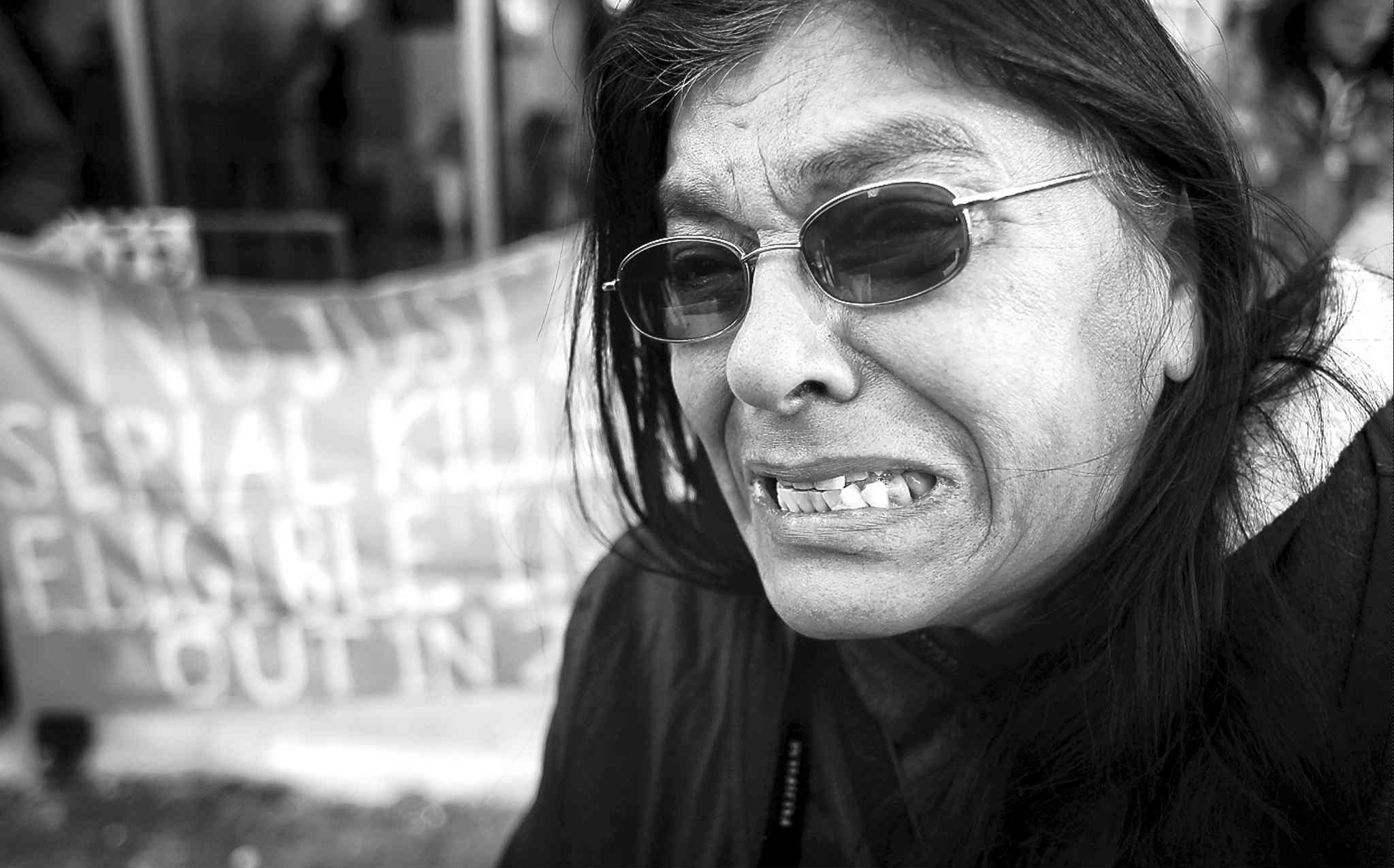 Gladys Radek speaks to the media as about 100 protesters gathered outside the Law Courts Building on Monday.