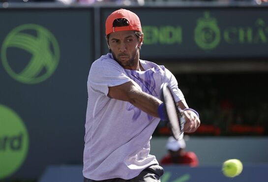 Fernando Verdasco, of Spain, hits a return to Rafael Nadal at the Miami Open tennis tournament, Sunday, March 29, 2015, in Key Biscayne, Fla. (AP Photo/Lynne Sladky)