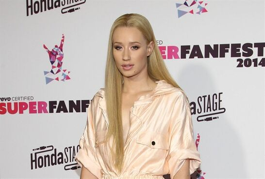 "FILE - In this Wed., Oct. 8, 2014 file photo, Iggy Azalea arrives at the Vevo Certified SuperFanFest Live Concert at the Barker Hangar in Santa Monica, Calif. Rapper Azalea, actor Bryan Cranston and the film ""Gone Girl"" are nominees for Logo TV's 2014 New Now Next Awards. The network announced Thursday, Oct. 23, 2014, that singer Sam Smith, the ABC series ""How to Get Away With Murder"" and the play ""Hedwig and the Angry Inch"" are also up for awards. The show will tape Dec. 2 in Miami, and air Dec. 7 on Logo and Dec. 12 on MTV. (Photo by Paul A. Hebert/Invision/AP, File)"