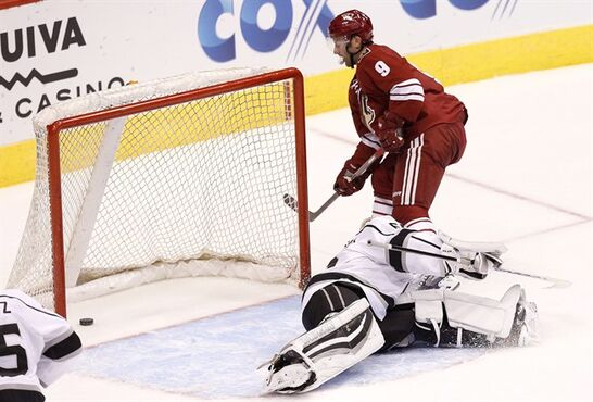Arizona Coyotes' Sam Gagner (9) scores a goal against Los Angeles Kings' Peter Bartosak during the second period of a preseason NHL hockey game Monday, Sept. 22, 2014, in Glendale, Ariz. (AP Photo/Ross D. Franklin)