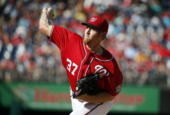 In this photo taken Sept. 27, 2014, Washington Nationals starting pitcher Stephen Strasburg (37) throws during the first inning of a baseball game against the Miami Marlins at Nationals Park in Washington. Two years after famously being shut down by the Washington Nationals to protect his elbow, Stephen Strasburg finally will make his postseason debut this week for the NL East champions.