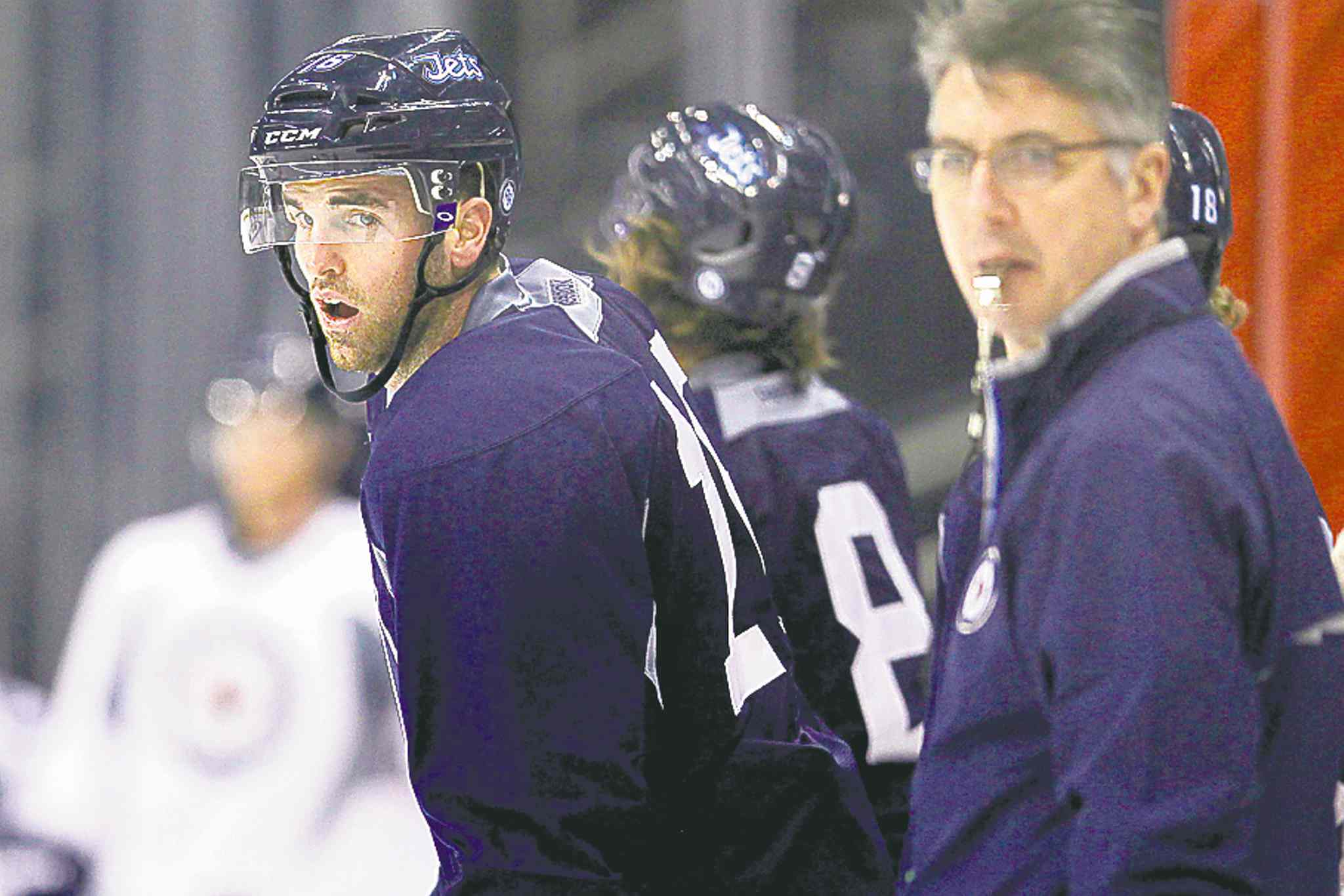 Andrew Ladd (left) and Claude Noel had a few tense moments on Thursday.