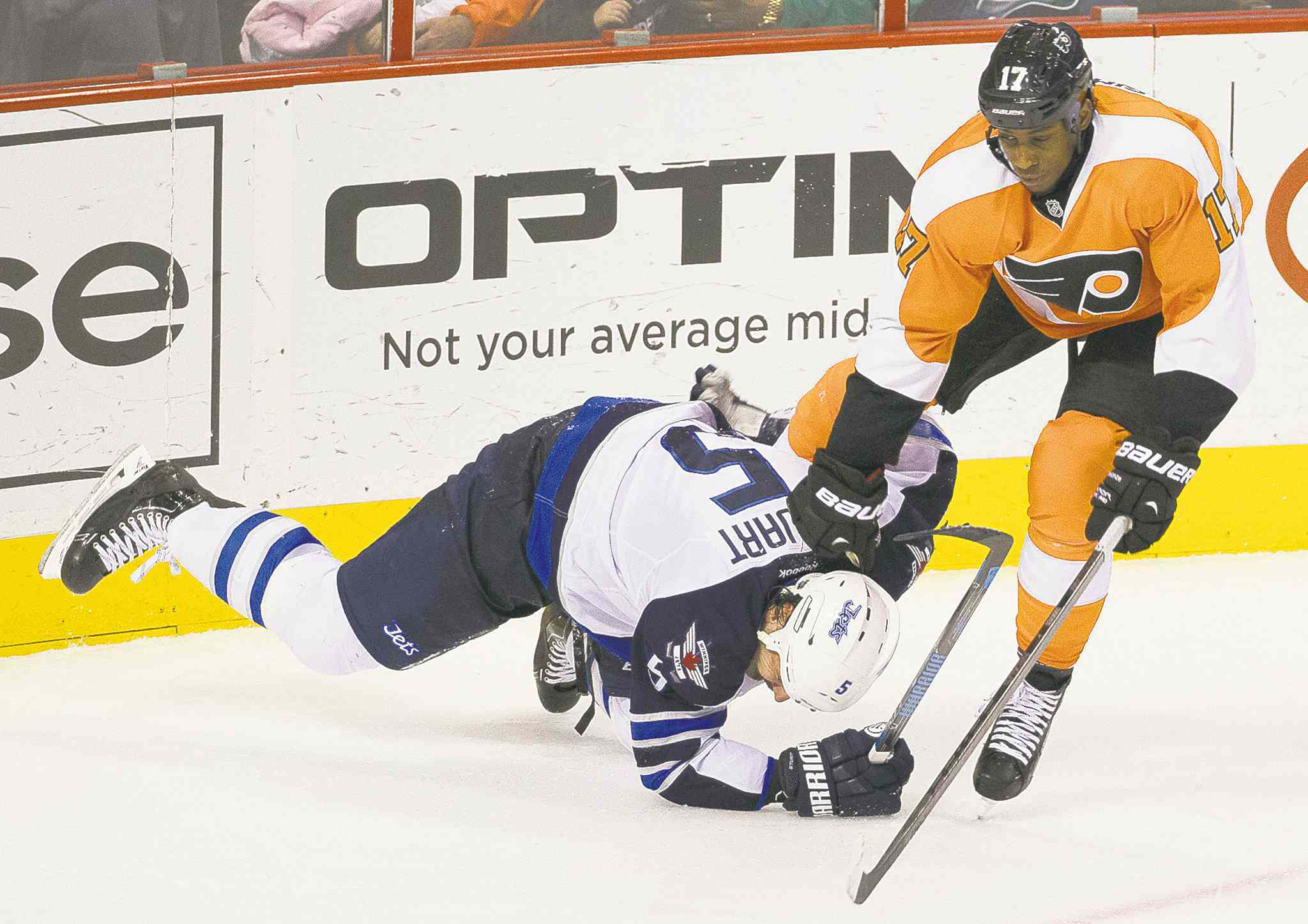 Jets defenceman Mark Stuart goes down after getting tangled up with Flyers forward Wayne Simmonds in the third period Friday.