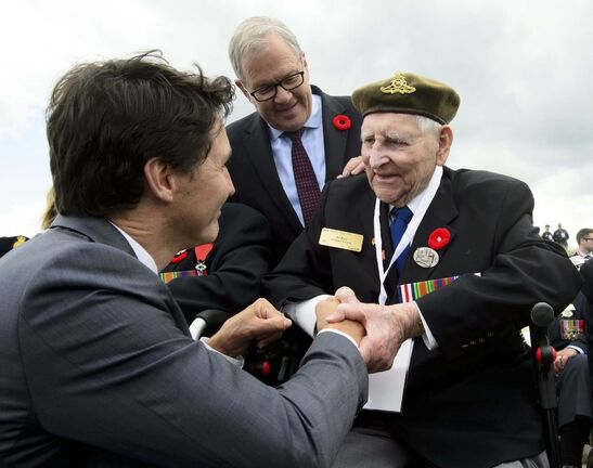 <p>Prime Minister Justin Trudeau shakes hands with Veteran of the Second World War Al Roy as he visits Juno Beach following the D-Day 75th Anniversary Canadian National Commemorative Ceremony  in Courseulles-Sur-Mer, France last Thursday.</p>