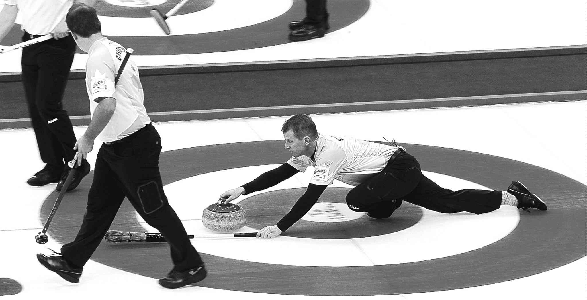 MIKE DEAL / WINNIPEG FREE PRESS archivesSkip Jeff Stoughton throws a rock on Dec. 2 during the Roar of the Rings at the MTS Centre.