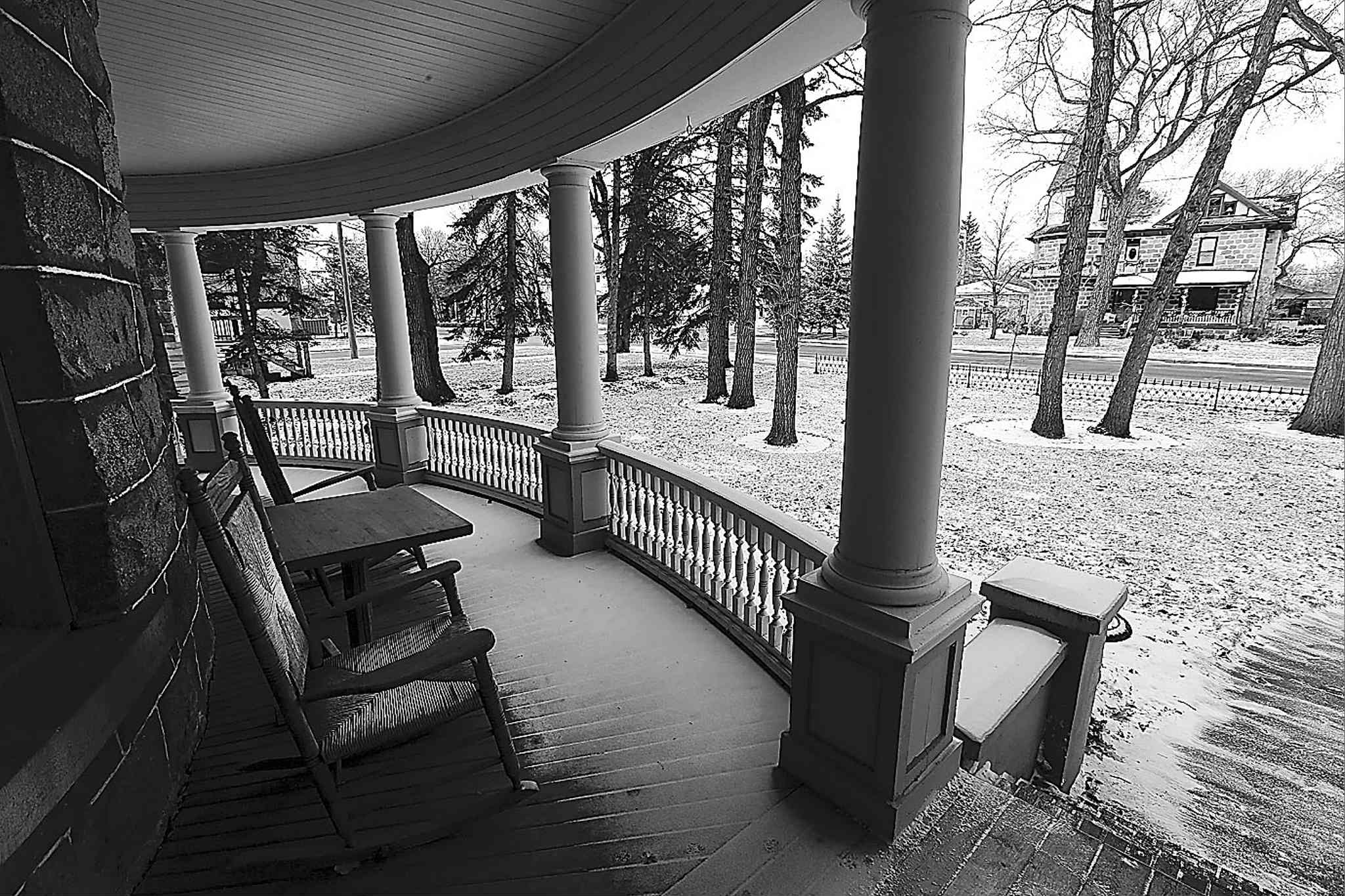 The curved front porch with a view of another historic stone house across Stephen Street. Only serious offers are being entertained.