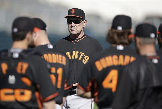 San Francisco Giants manager Bruce Bochy (15) talks to the team during spring training baseball practice Friday, Feb. 27, 2015, in Scottsdale, Ariz. (AP Photo/Darron Cummings)