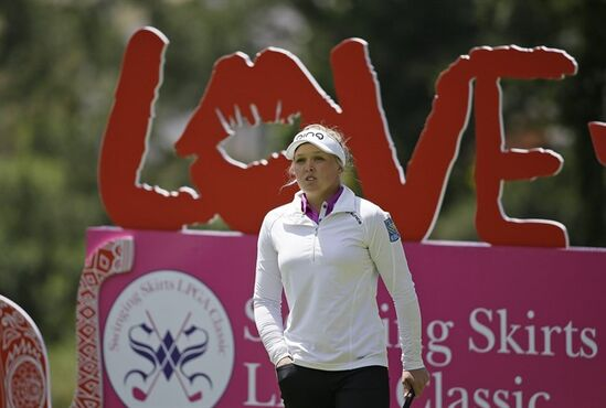 Brooke Henderson of Canada prepares to hit from the fourth tee of the Lake Merced Golf Club during the third round of the Swinging Skirts LPGA Classic golf tournament Saturday, April 25, 2015, in Daly City, Calif. (AP Photo/Eric Risberg)
