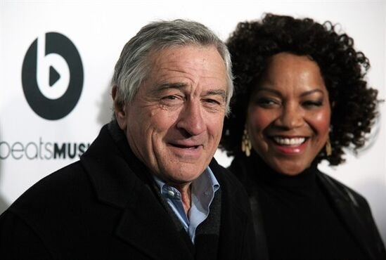 Tribeca Film Festival co-founder and actor Robert De Niro, left, with his wife Grace Hightower, attends the world premiere of