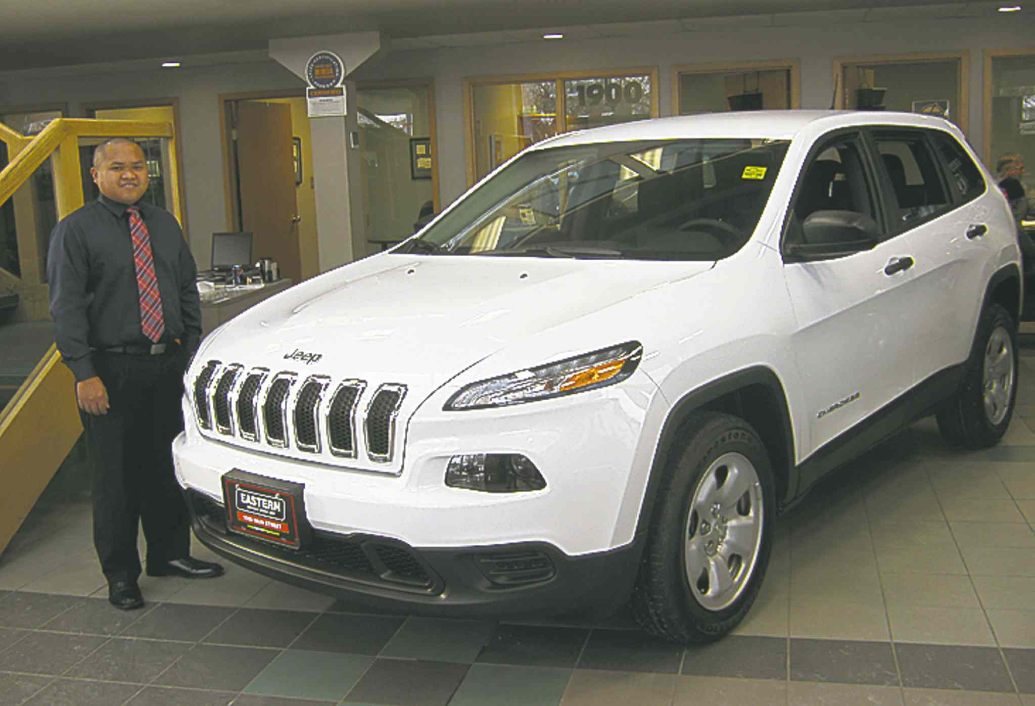 Eastern Chrysler Dodge Jeep sales rep Rod Francisco with the  2014 Jeep Cherokee.