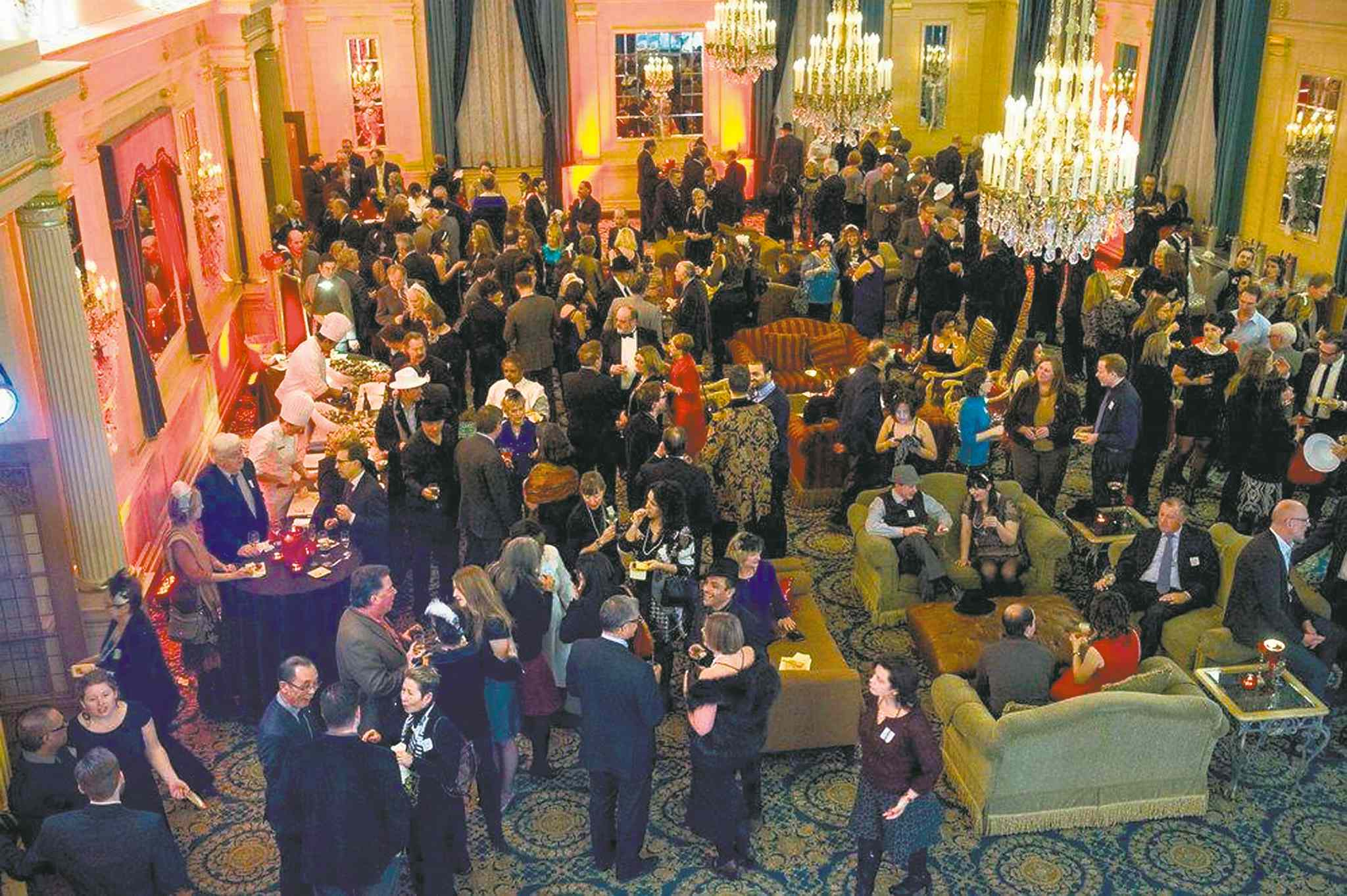 An invitation-only crowd celebrates the hotel's 100th anniversary on Wednesday.