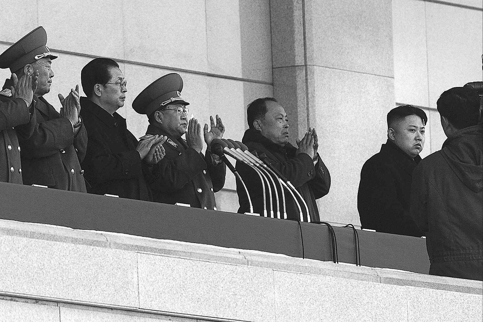North Korean leader Kim Jong Un (right) is seen in this 2012 photo with his uncle Jang Song Thaek (second from left). Jang, considered the No. 2 official, was executed last week.