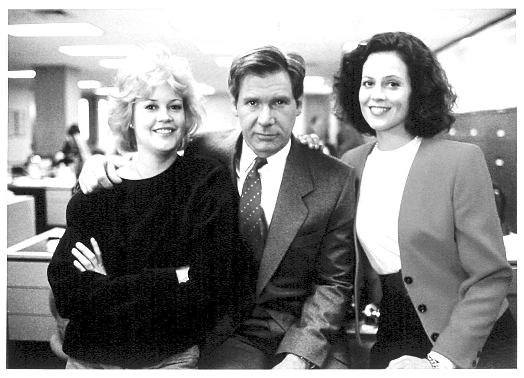 The 1988 blockbuster Working Girl, starring (from left) Melanie Griffith, Harrison Ford and Sigourney Weaver, depicted the glass ceiling. Many feel little has changed.