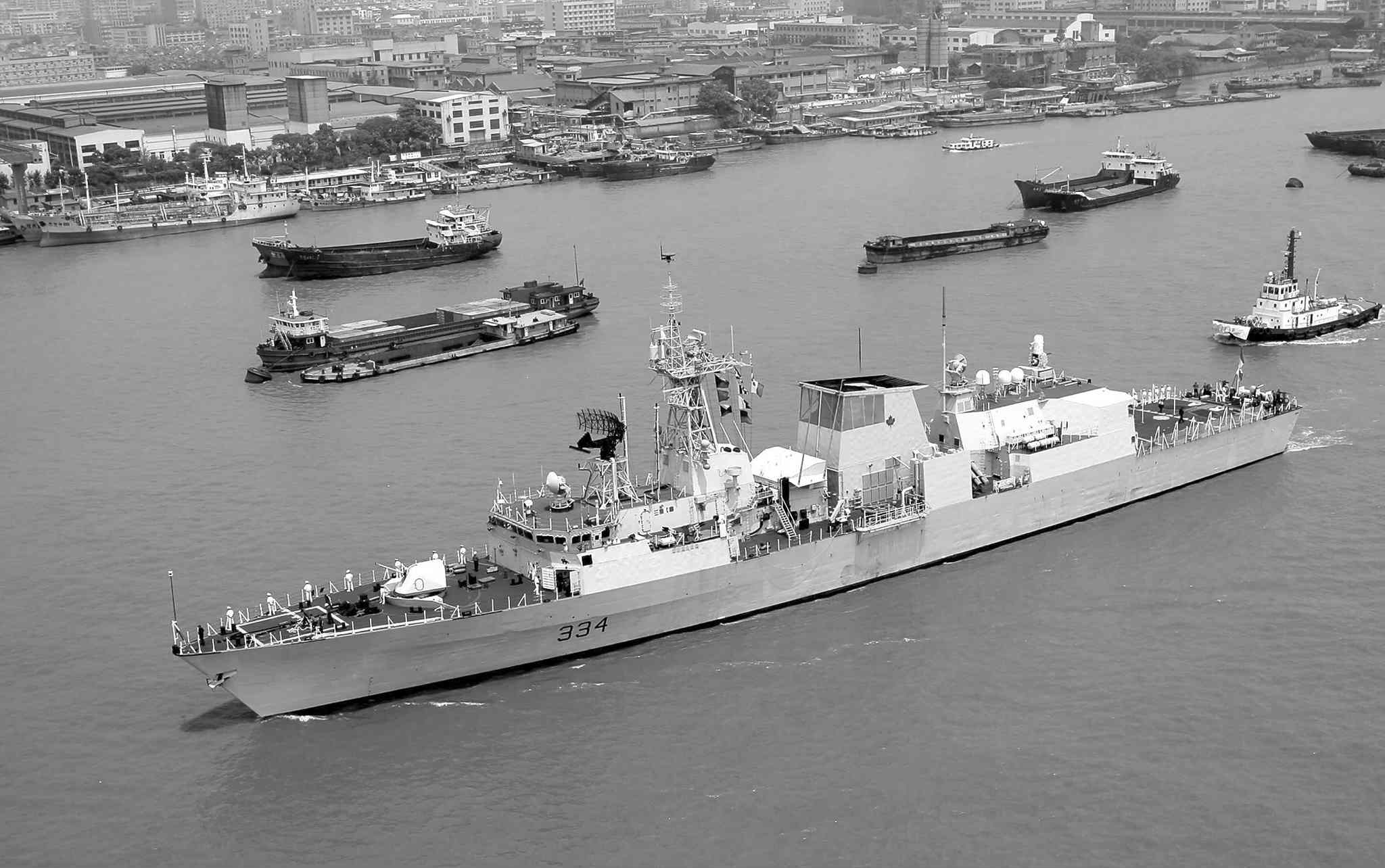 The Royal Canadian Navy�s HMCS Regina plies Chinese waters in Shanghai.