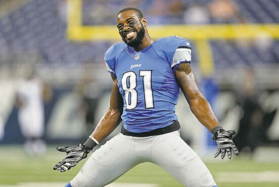 Detroit Lions wide receiver Calvin Johnson smiles during warmups before a preseason NFL football game against the Jacksonville Jaguars at Ford Field in Detroit, Friday, Aug. 22, 2014. (AP Photo/Rick Osentoski)