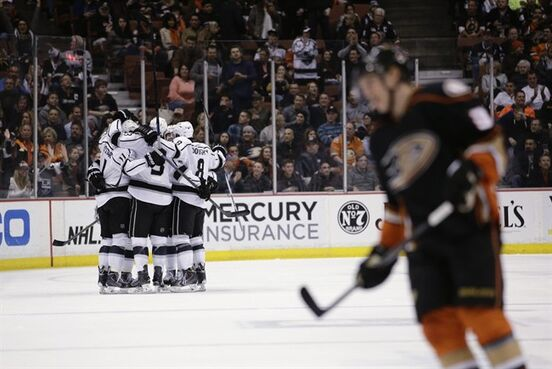 Los Angeles Kings celebrate a goal by Brayden McNabb as Anaheim Ducks' Jakob Silfverberg, of Sweden, skates in the foreground during the second period of an NHL hockey game, Friday, Feb. 27, 2015, in Anaheim, Calif. (AP Photo/Jae C. Hong)