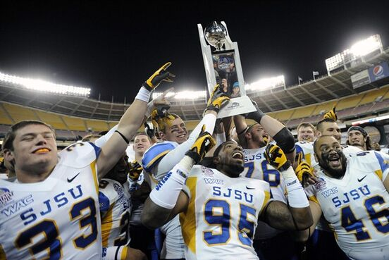 FILE - In this Dec. 27, 2012 file photo, San Jose State players, including linebacker Brad Kuh (33), defensive end Sean Bacon (95) and running back Ray Rodriguez (46), celebrate a 29-20 win over Bowling Green in the NCAA college football Military Bowl, in Washington. The Military Bowl is headed to Navy-Marine Corps Memorial Stadium in Annapolis. The DC Bowl Committee and Events DC announced Monday that this year's game will be moved from RFK Stadium in Washington to the venue that is home to the U.S. Naval Academy Midshipmen. The Dec. 27 game presented by Northrop Grumman to benefit the USO will be the sixth annual Military Bowl. (AP Photo/Nick Wass, File)