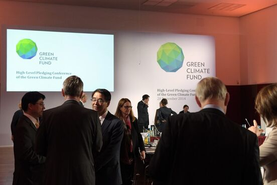 Delegates and participants of the Green Climate Fund talk to each other prior the meeting in Berlin, Germany, Thursday Nov. 20, 2014. A United Nations fund that will help poor countries tackle climate change has fallen short for now of its target of collecting US $10 billion, officials said Thursday. Some 30 countries meeting in Berlin pledged a total of $9.3 billion toward the Green Climate Fund. (AP Photo/dpa,Rainer Jensen)