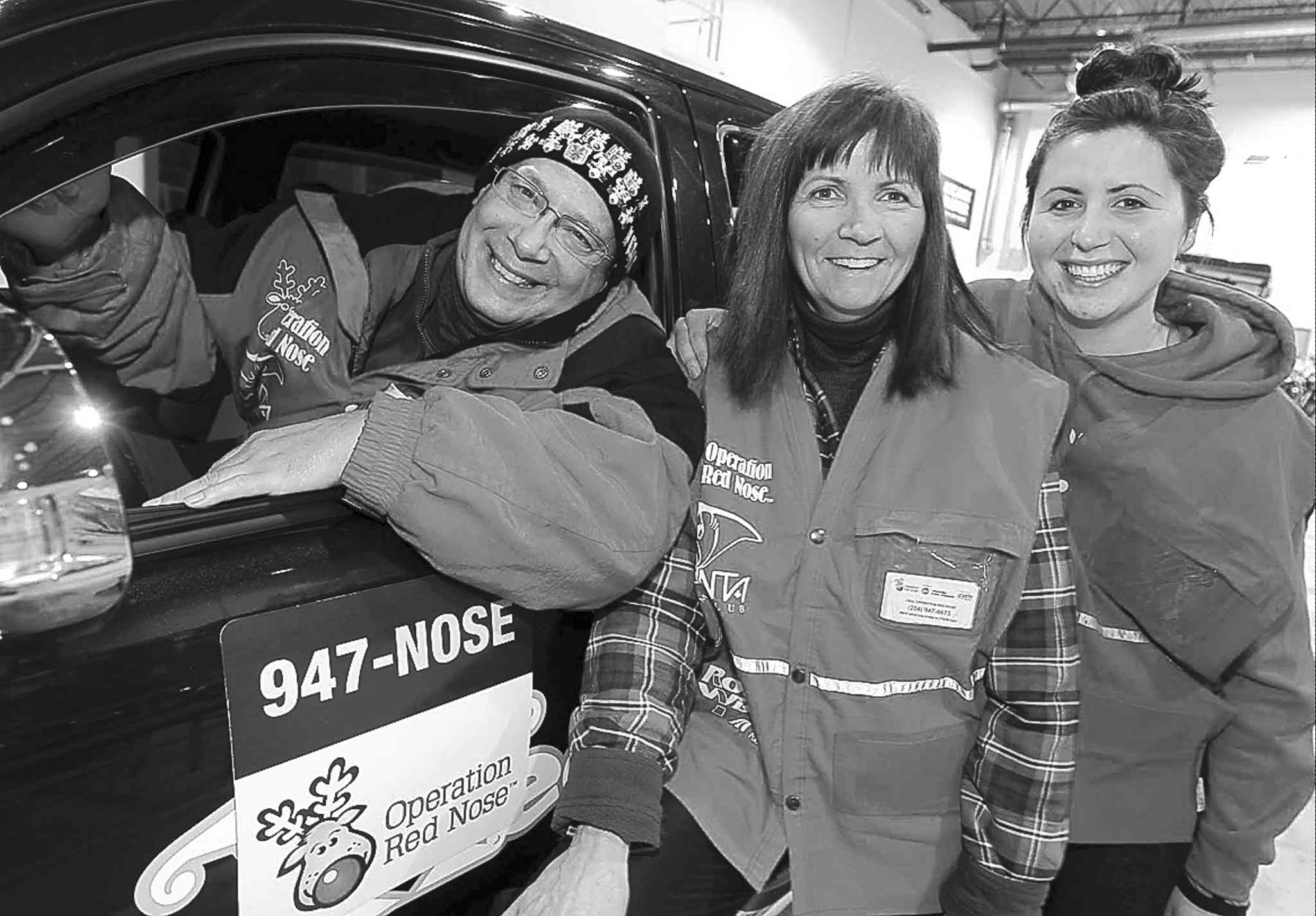 BORIS MINKEVICH / WINNIPEG FREE PRESS SFlbOperation Red Nose volunteers (from left) Allan Kauk, Michele Rousseau and Janelle Asselin will brave the cold this holiday season to get partygoers and their vehicles home safely.