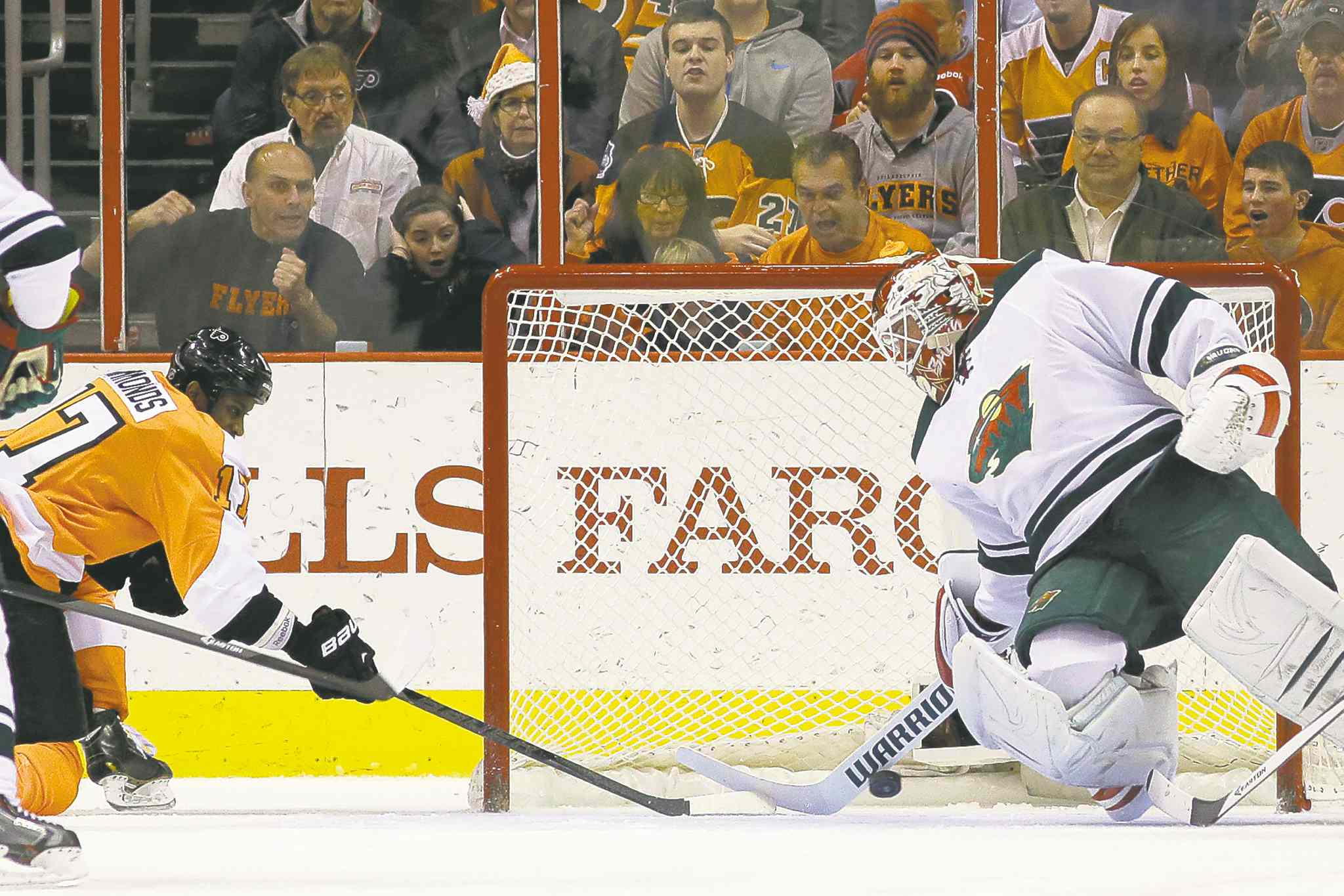 Philadelphia's Wayne Simmonds puts a shot past the Minnesota Wild's Niklas Backstrom on Monday night.