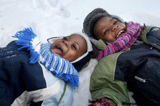 Young brothers Silla Musaka, 3, (left) and Manuel, 4, enjoy a frosty Winnipeg afternoon. Their parents are from Congo and are adapting well to their new life in Canada. Today the Free Press presents the Africa edition, an editorial project designed to explore the city and province's ties to Africa.