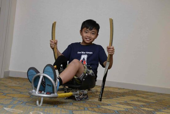 Bernard Rosello hasn't let his physical limitations get in the way of his athletic pursuits. Rosello, 9, plays soccer, some basketball, and a lot of sledge hockey.