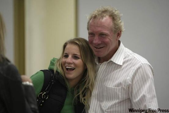 While waiting for the advanced poll results Wednesday night, Thomas Steen laughs with his daughter Cassandra.