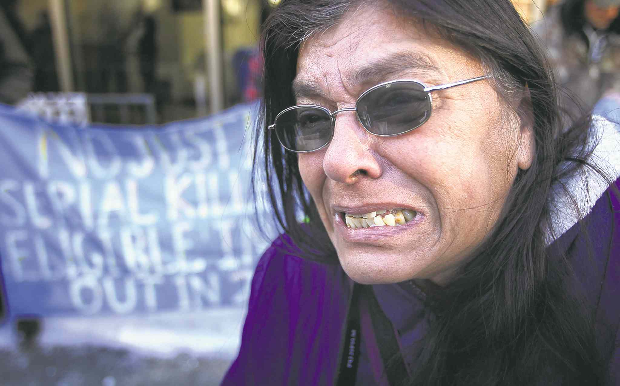 An emotional Gladys Radek speaks to the media during a protest  outside the Law Courts earlier this year. Retired police  officer James Jewell says investigations into killings of drug addicted sex-trade workers are very difficult.