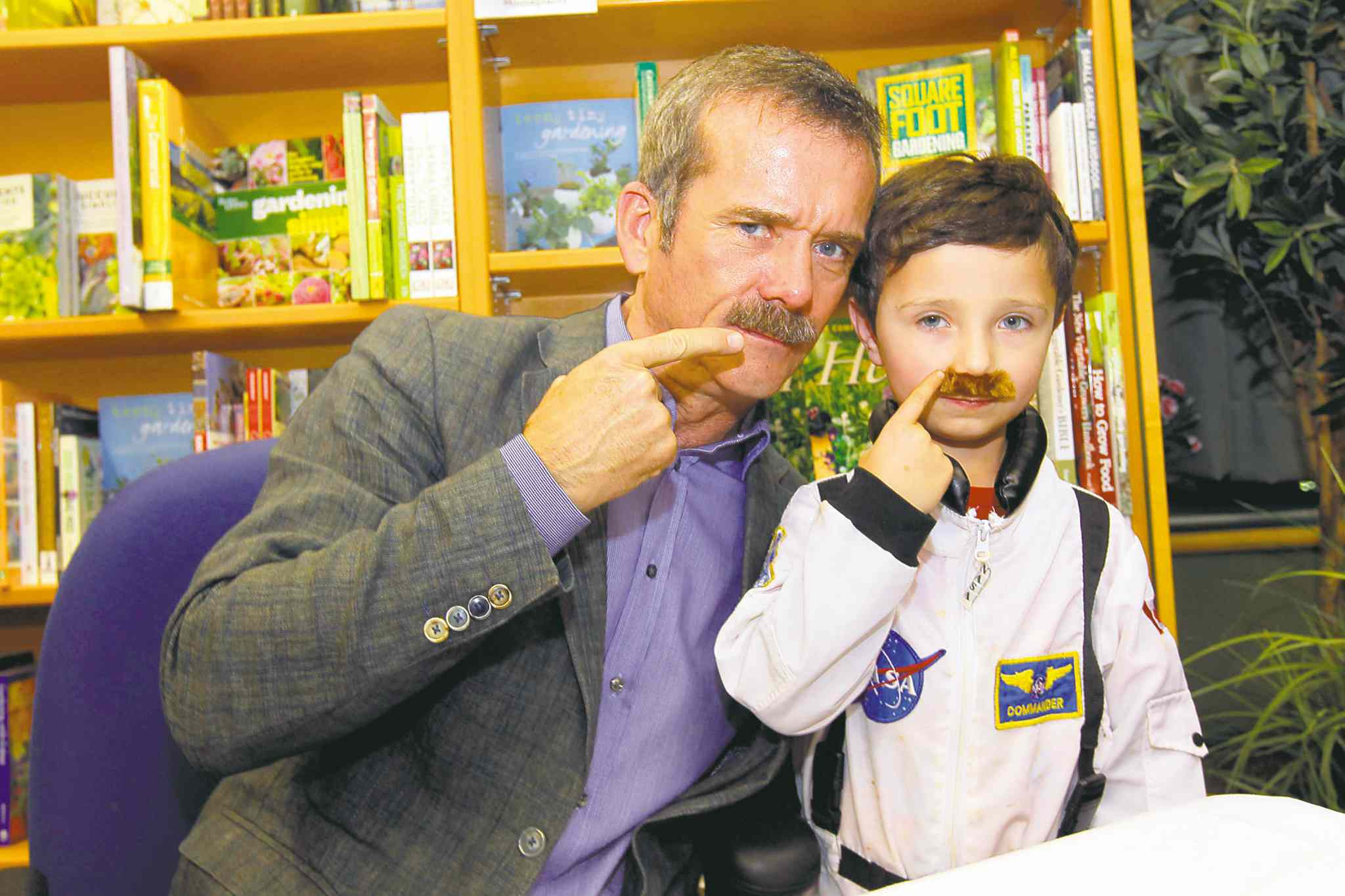 Chris Hadfield with lookalike Kahy Thompson earlier this year at McNally Robinson in Winnipeg.