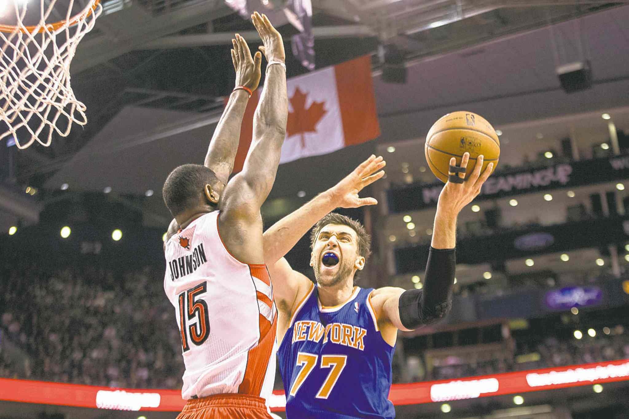 Chris Young / the canadian pressNew York�s Andrea Bargnani (right) shoots over Toronto�s Amir Johnson.