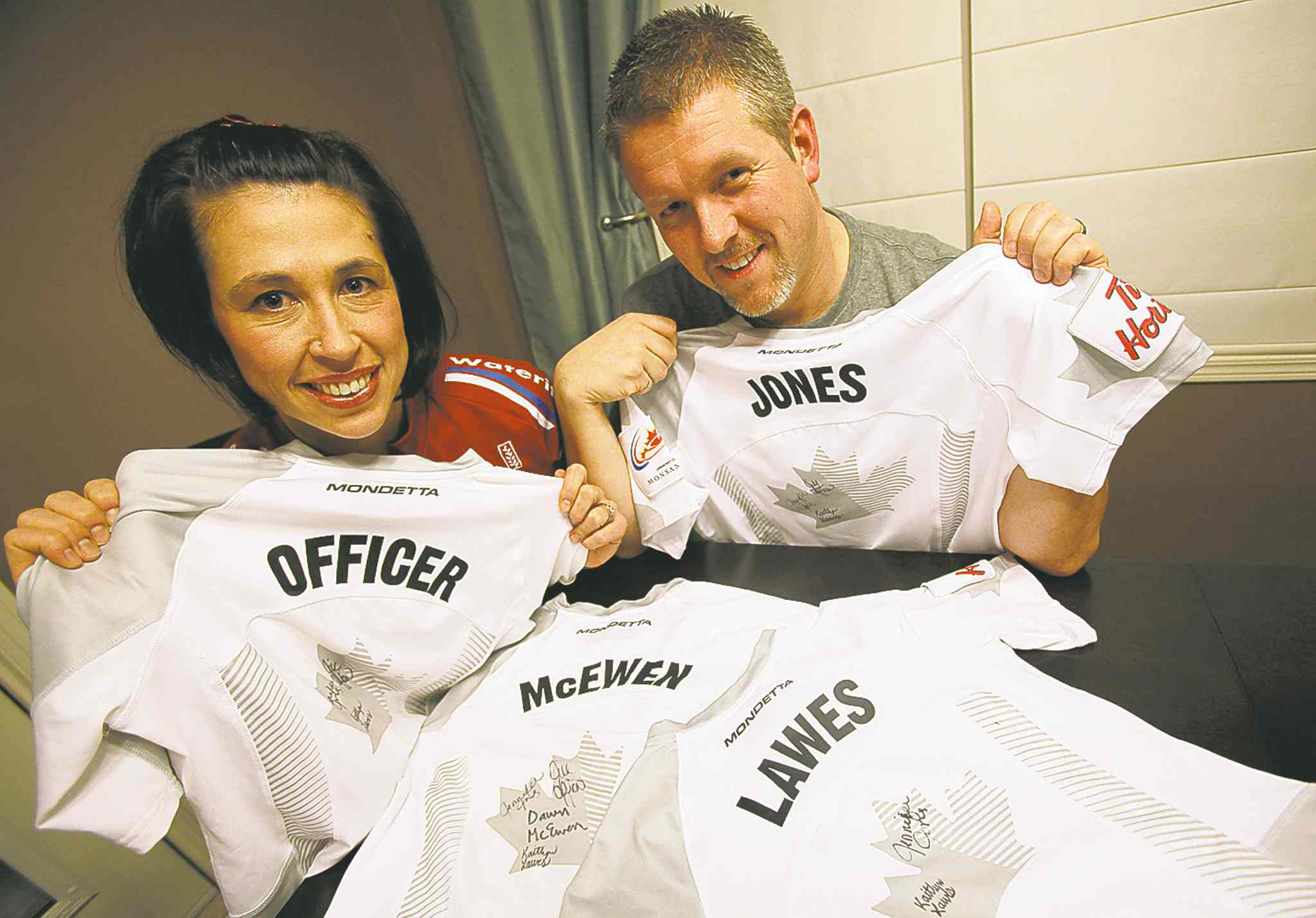 Members of the Jennifer Jones curling team competing in Sochi are auctioning signed jerseys from the Olympic trials to help cover the travel costs of their families. Devlin Hinchey said he'll be in Russia to root for his wife, second Jill Officer, regardless of the cost.