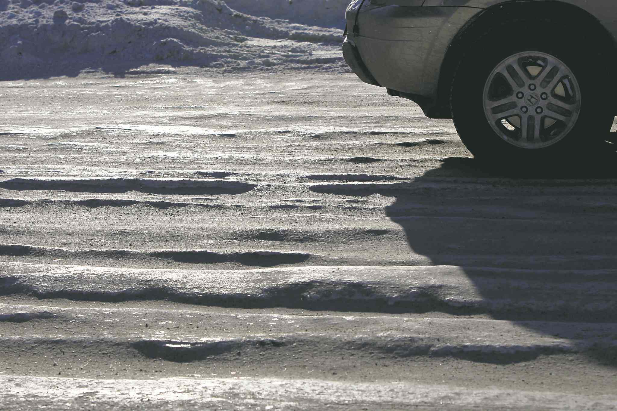 Icy, rutted patches on Logan Avenue near Route 90 Monday. The snow clearing operation that begins tonight will clear the potentially dangerous ruts which have developed throughout the city.
