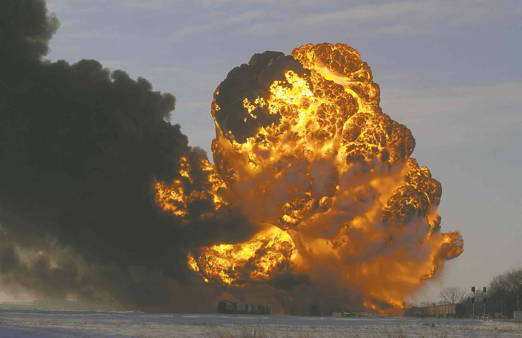 A fireball goes up at the site of an oil train derailment in Casselton, N.D. The 2,400 residents have been urged to evacuate.