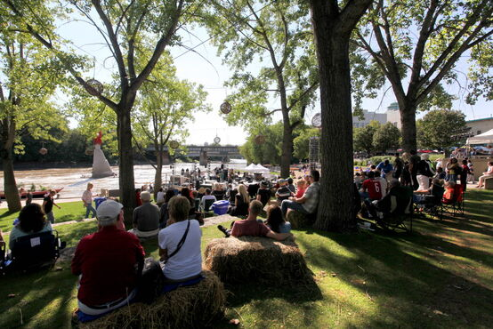 People gather along the waterfront at The Forks Saturday during the Prairie Barge Festival. Manitoba and Saskatchewan artists are teaming up for three days of music, art and culture showcasing the diverse talent of the Prairies. The festival runs until Sunday.