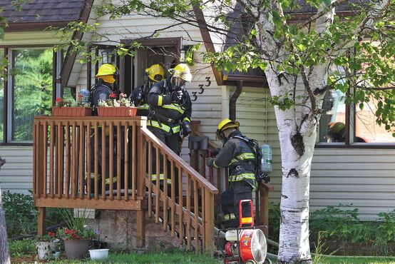 Firefighters attend a house fire at 333 Rutland Street close to Ness Avenue. Winnipeg Fire District Chief Stadnyk reported that their were no injuries, but the family has been transported to hospital for assessment. Damage could reach $25,000.