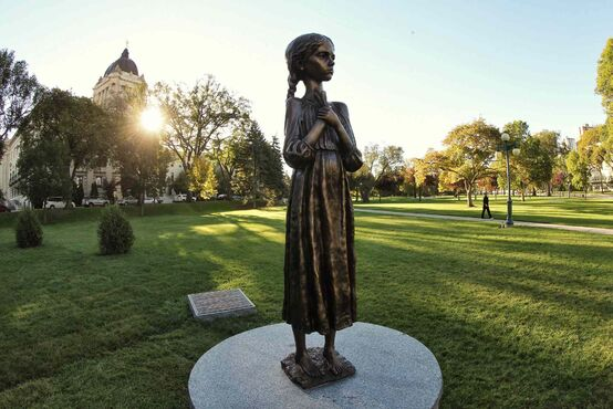A pedestrian walks past a new monument on the grounds of the Manitoba Legislative Building Monday morning. Entitled,