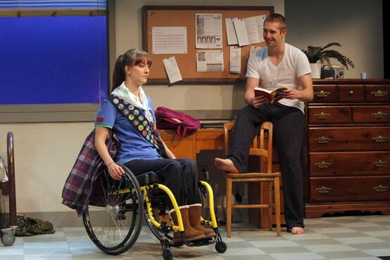 Cpl. Michael Armstrong (played by Justin Otto) and Halley Armstrong (played by Heather Russell) are seen in a scene from Armstrong's War by Colleen Murphy.