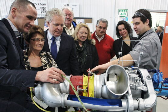 Kevin Chief (from left), Marileen Bartlett, Jean Charest, Wayne Helgason, Dorothy Dobbie, Bill Shead and board member Tanis Wheeler with CNC instructor Drew Tapley.