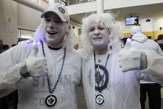Mike Reid (left) and Paul Leaden (right) are in full whiteout attire as they arrive prior the to third game of the Stanley Cup playoff series between the Winnipeg Jets and the Anaheim Ducks at MTS Centre Monday night.